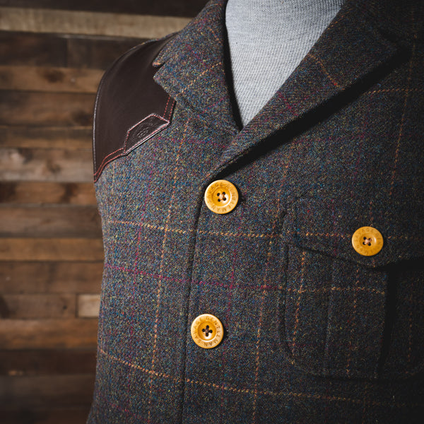 Savage Gentleman Ketchum Vest with custom buttons and beautiful red, yellow, and blue weave.