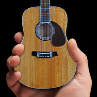 Classic Natural Finish Acoustic Miniature Guitar Replica Collectible  This collectible miniature guitar replica was handcrafted out of solid wood. The back has a rich rosewood stain and stunning detail. This is a great replica of a classic natural finish standard acoustic.
