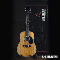 Classic Natural Finish Acoustic Miniature Guitar Replica Collectible  This collectible miniature guitar replica was handcrafted out of solid wood. The back has a rich rosewood stain and stunning detail. This is a great replica of a classic natural finish standard acoustic. in box