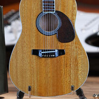 Classic Natural Finish Acoustic Miniature Guitar Replica Collectible  This collectible miniature guitar replica was handcrafted out of solid wood. The back has a rich rosewood stain and stunning detail. This is a great replica of a classic natural finish standard acoustic. close up