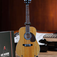 Classic Natural Finish Acoustic Miniature Guitar Replica Collectible  This collectible miniature guitar replica was handcrafted out of solid wood. The back has a rich rosewood stain and stunning detail. This is a great replica of a classic natural finish standard acoustic. on desk