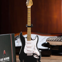 Fender™ Strat™ Classic Black Miniature AXE Guitar Replica - Officially Licensed Collectible (FS-002) on the desk