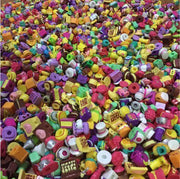 This is a Mixed Lot of 50 random Shopkins that may include items from series 1 through Series 7  No duplicates will be included Will include a mix of Small, Medium and Large
