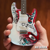 Jimi Hendrix Miniature Fender™ Strat™ Monterey Guitar Model - Officially Licensed Collectible (JH-801) in hand
