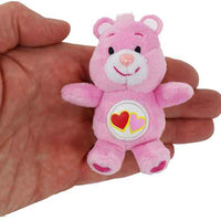 World's Smallest Care Bears Series 2 - Love a Lot Bear in hand