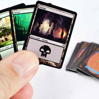World's Smallest Magic The Gathering  Jace vs. Vraska Duel Decks playing the game