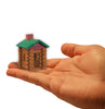 World's Smallest Lincoln Logs in hand