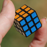 World's Smallest Rubik's Cube in hand
