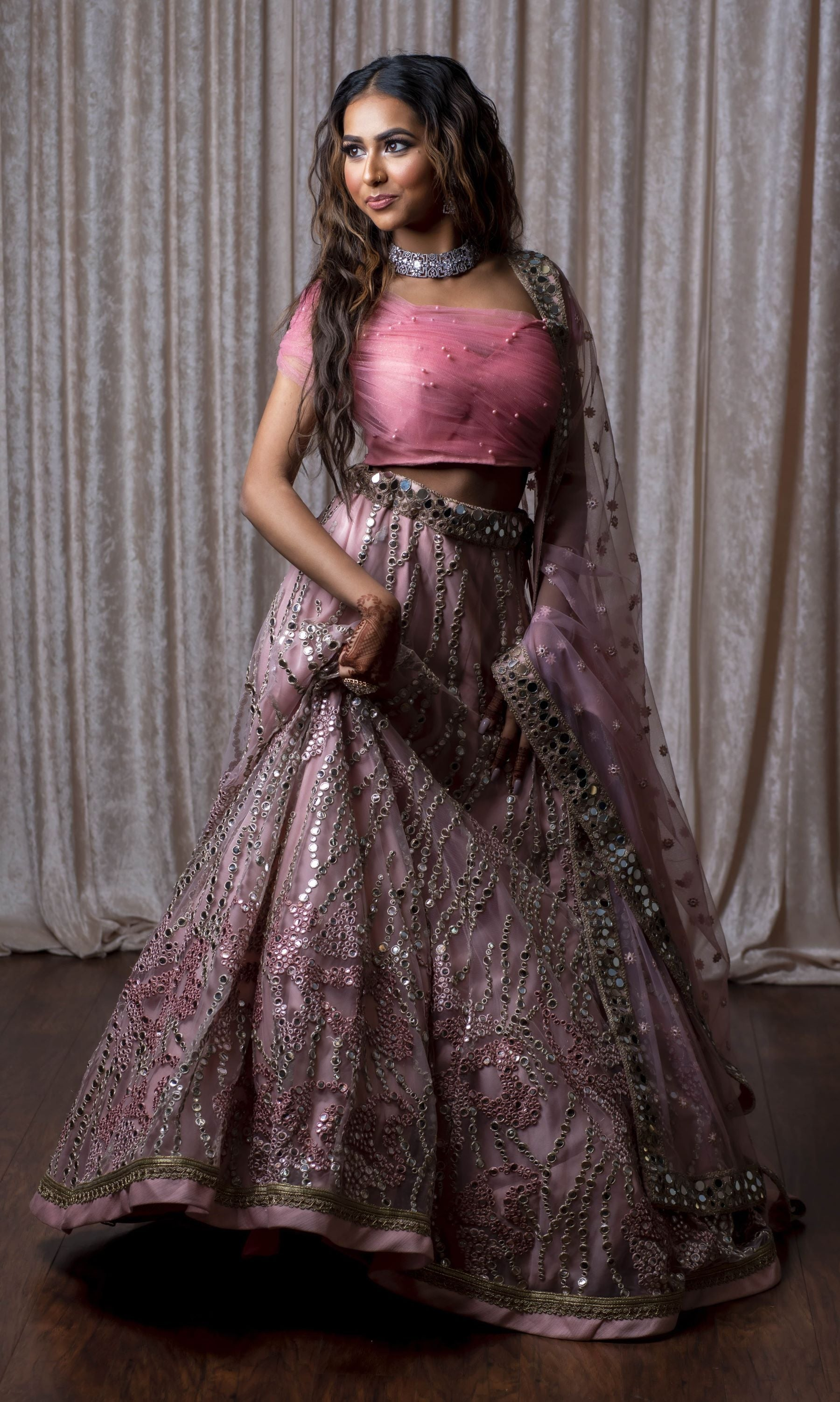 Pink net lehenga with one shoulder blouse