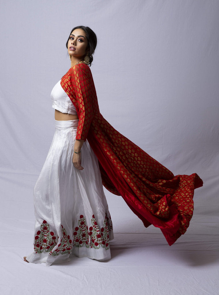 White lehenga set with a red jacket