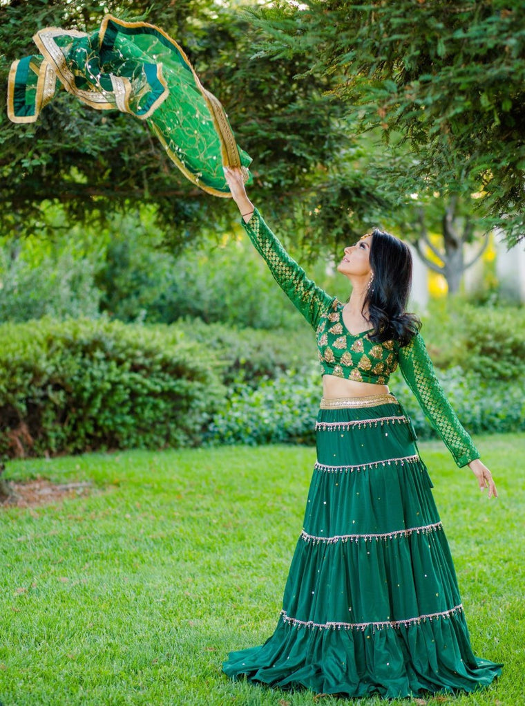 Emerald Green Tiered Crepe Lehenga with Full sleeved Statement Brocade Blouse