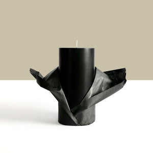 Black pillar candle wrapped