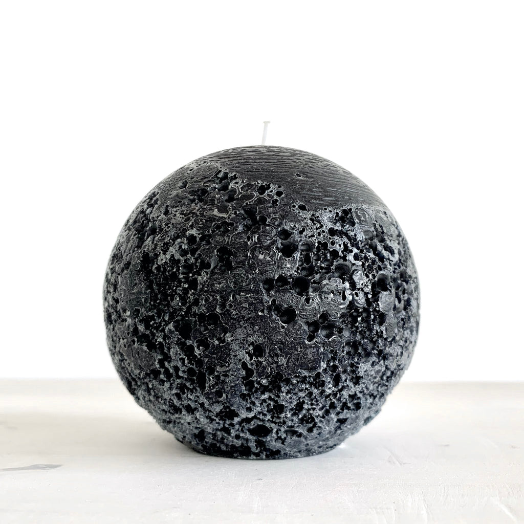 Large black spherical candle