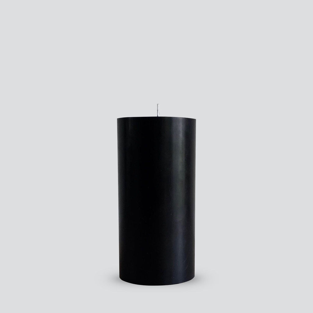 Large black pillar candle