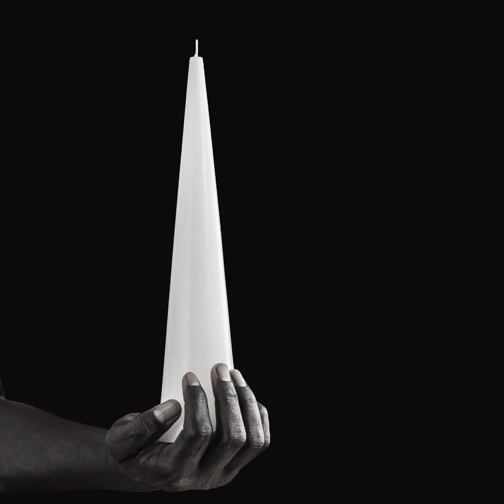 Large white sculptural cone candle