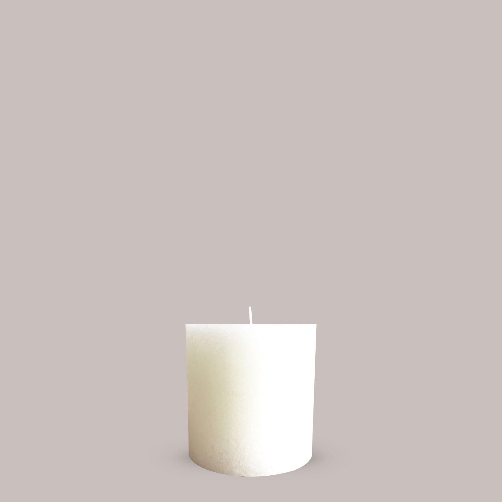 Large textured candle in warm white