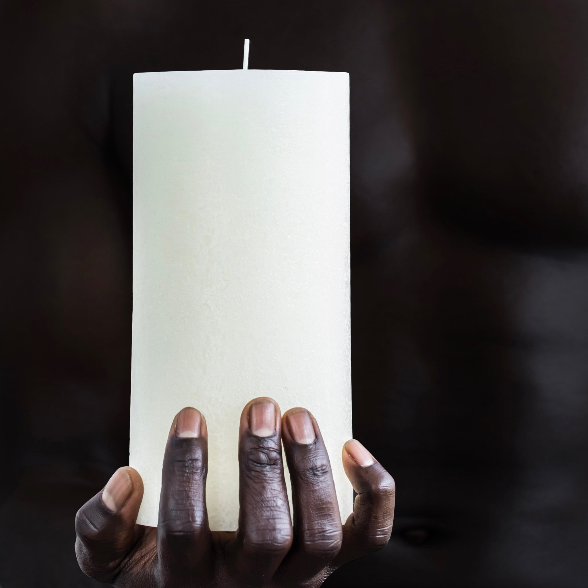 Tall white textured candle