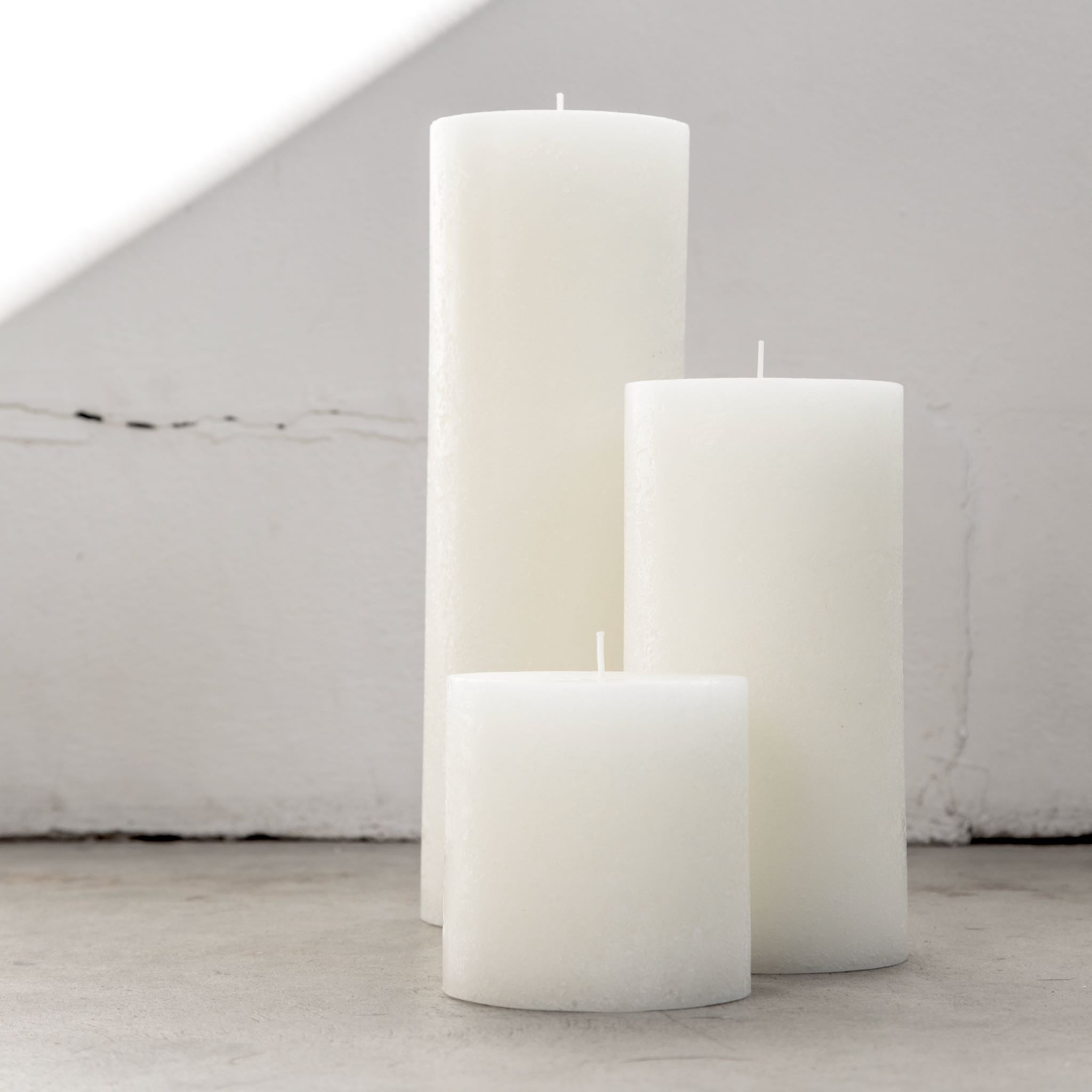 Large textured candles in warm white
