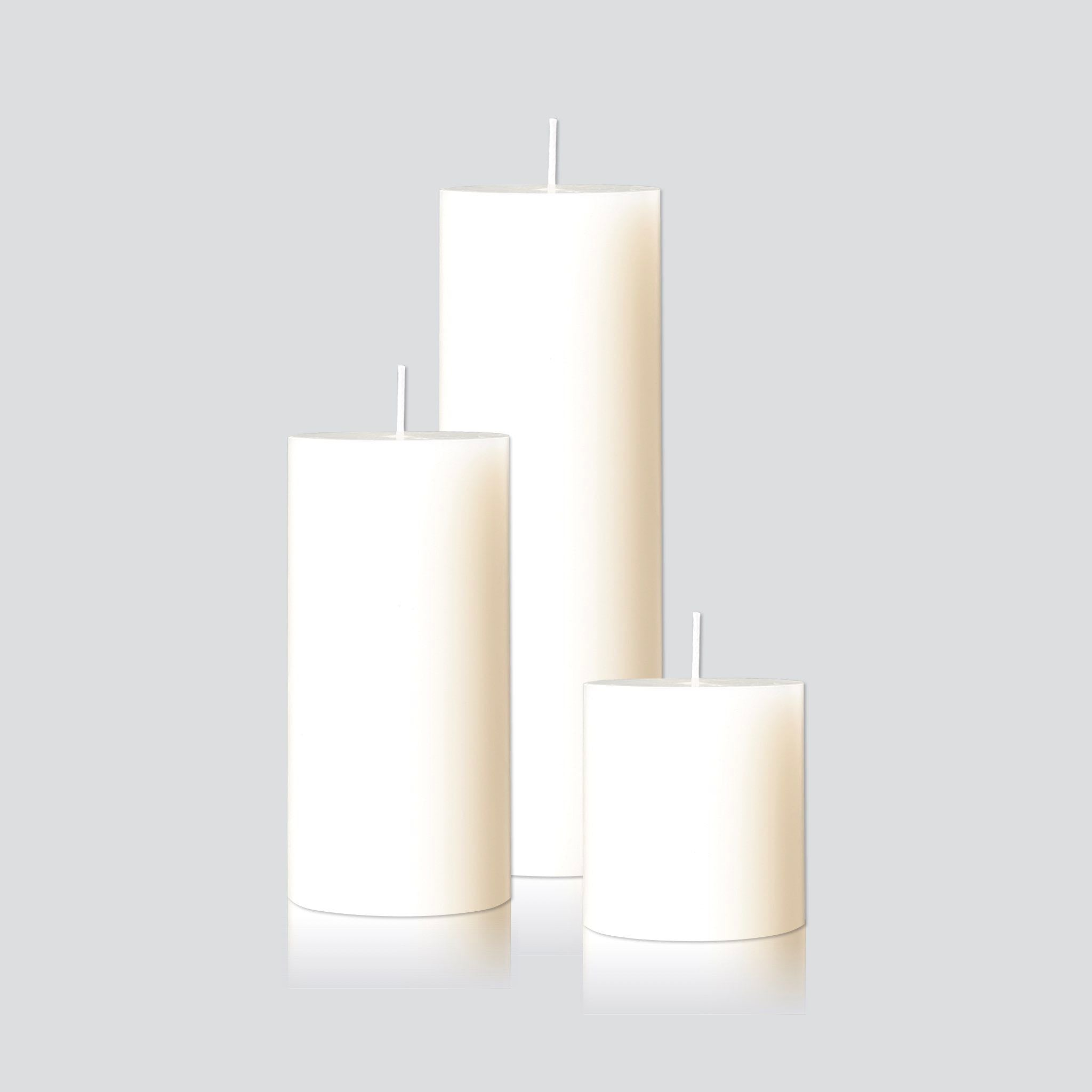Large white pillar candles