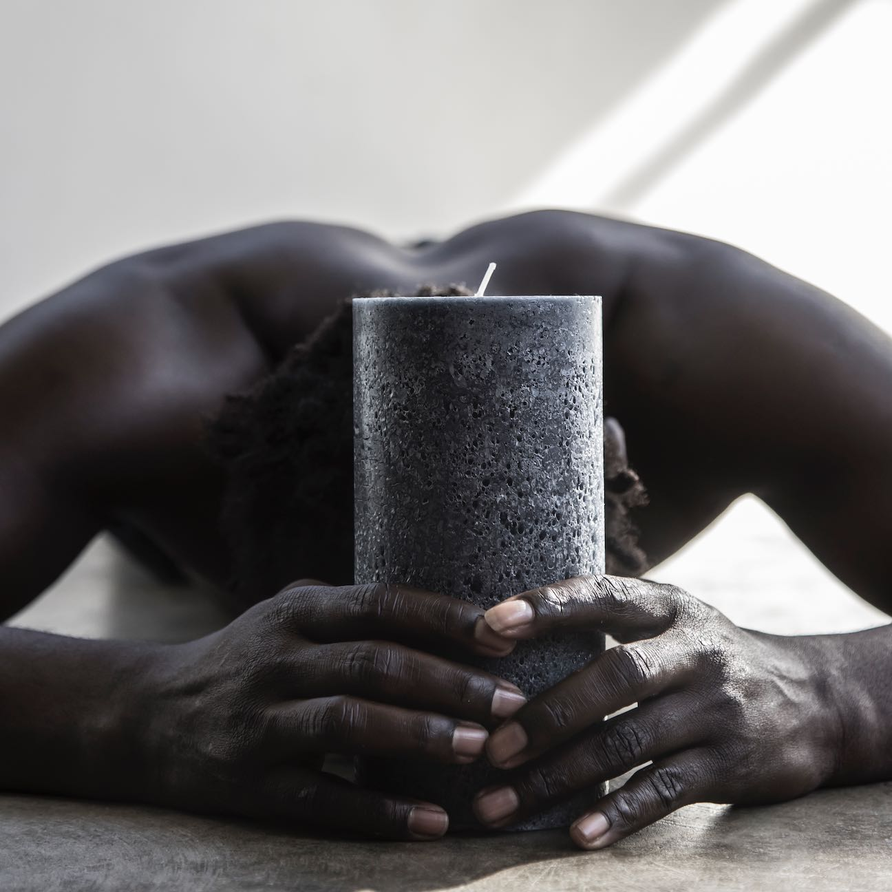 Tall charcoal textured pillar candle