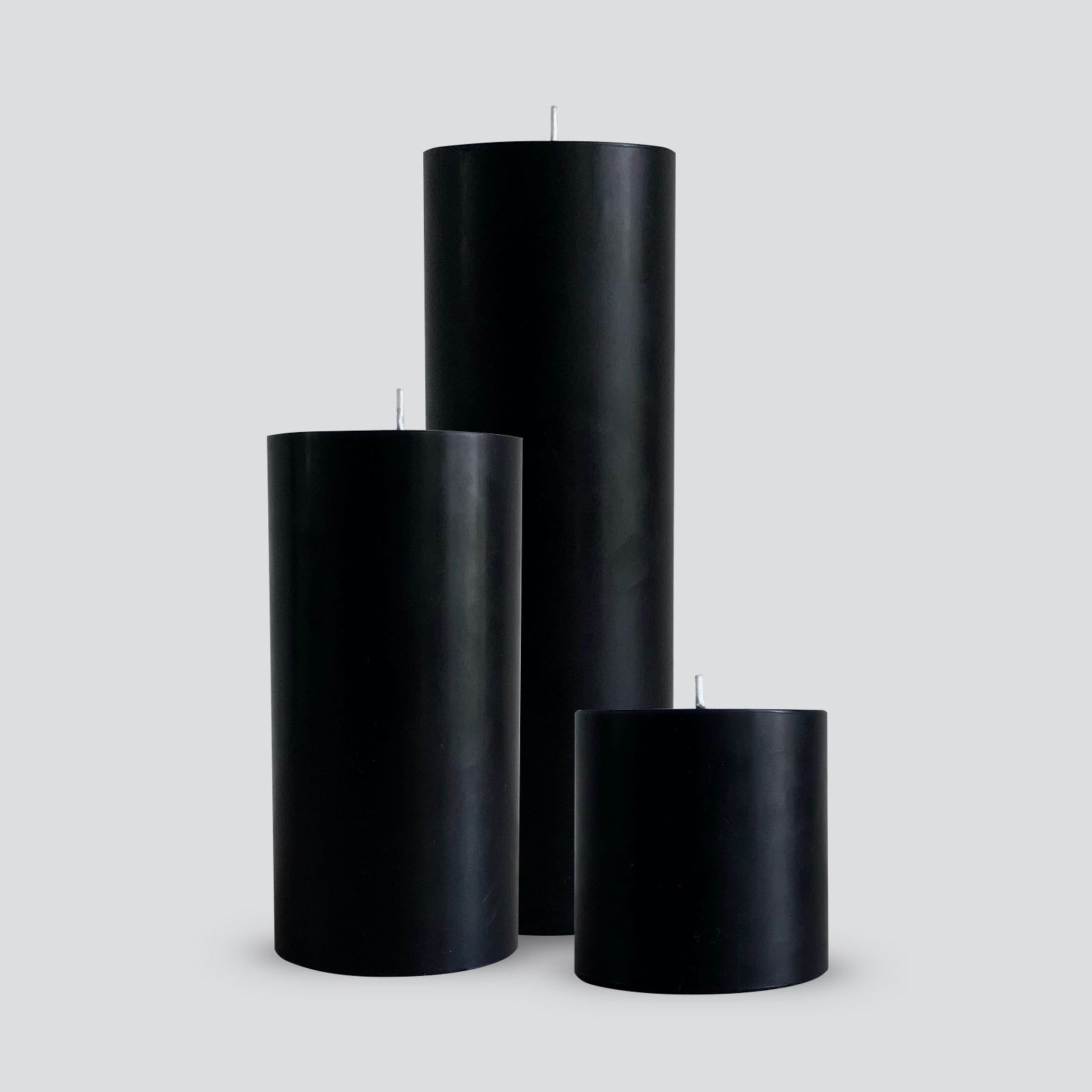 Large black pillar candles