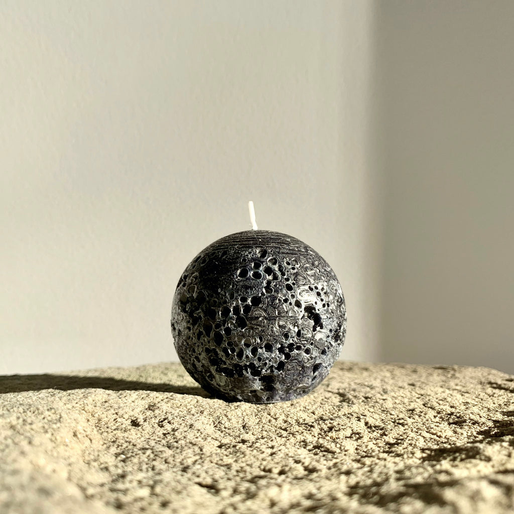 Rustic black sphere candle