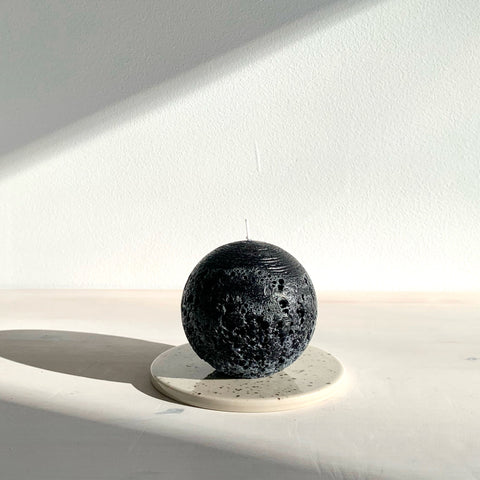 Rustic black ball candle