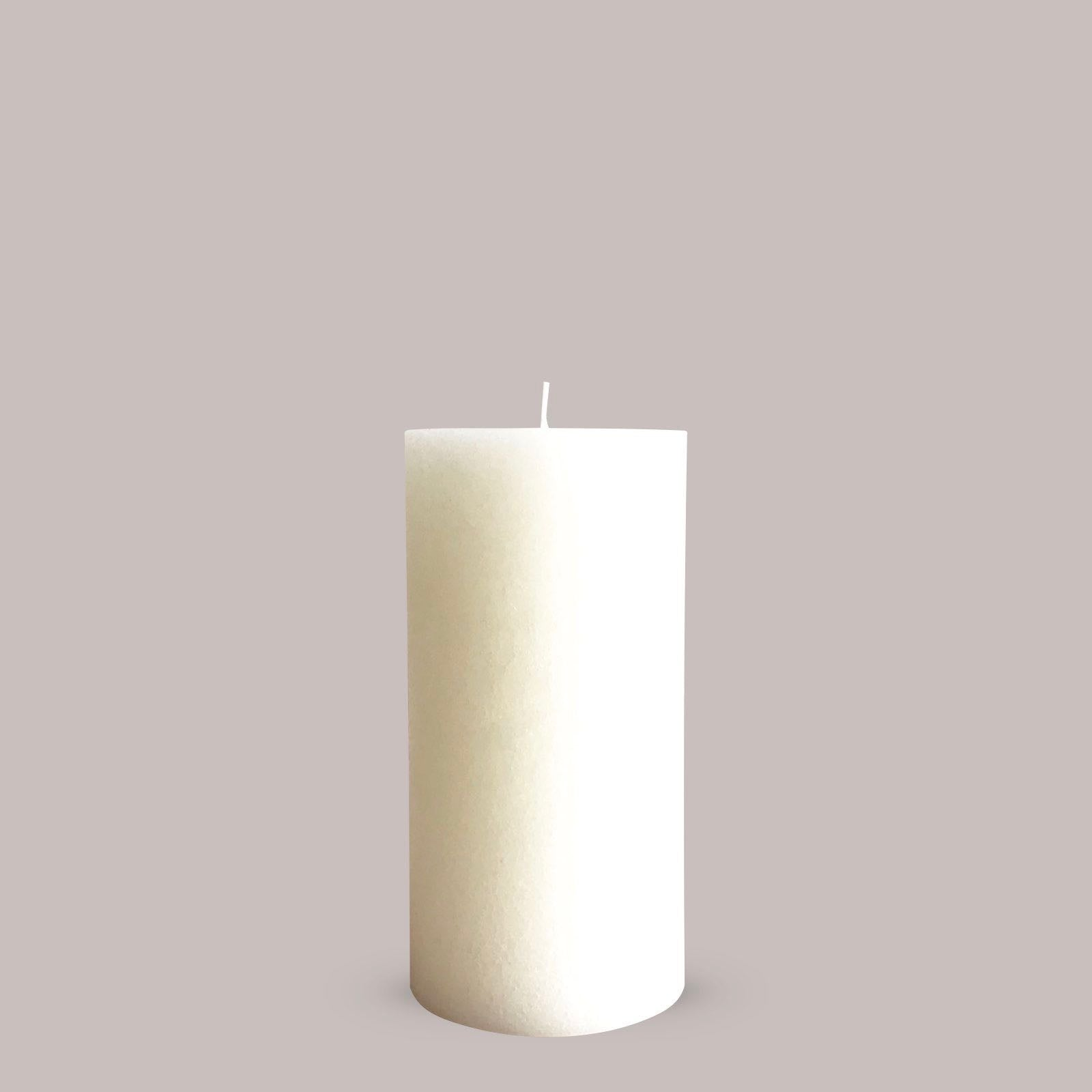 Tall warm white textured chapel candle