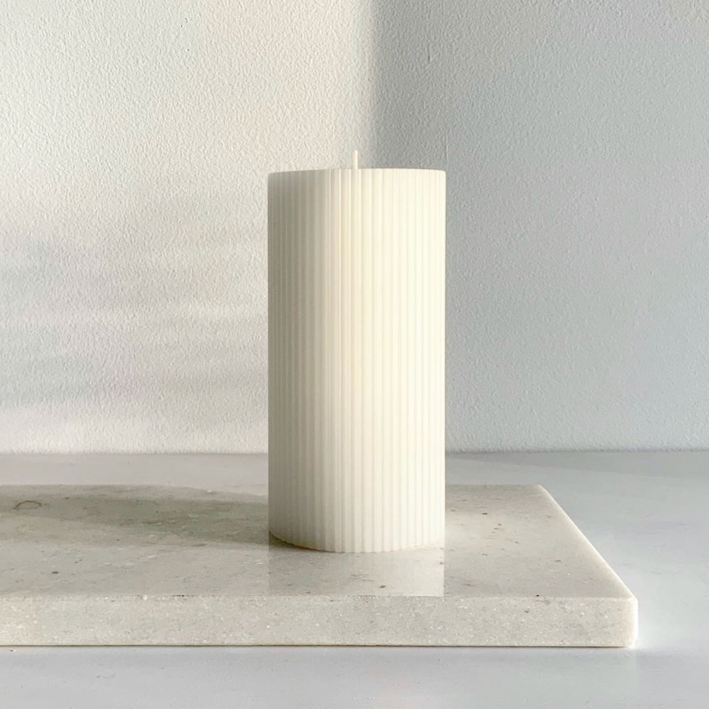 Ribbed white pillar candle