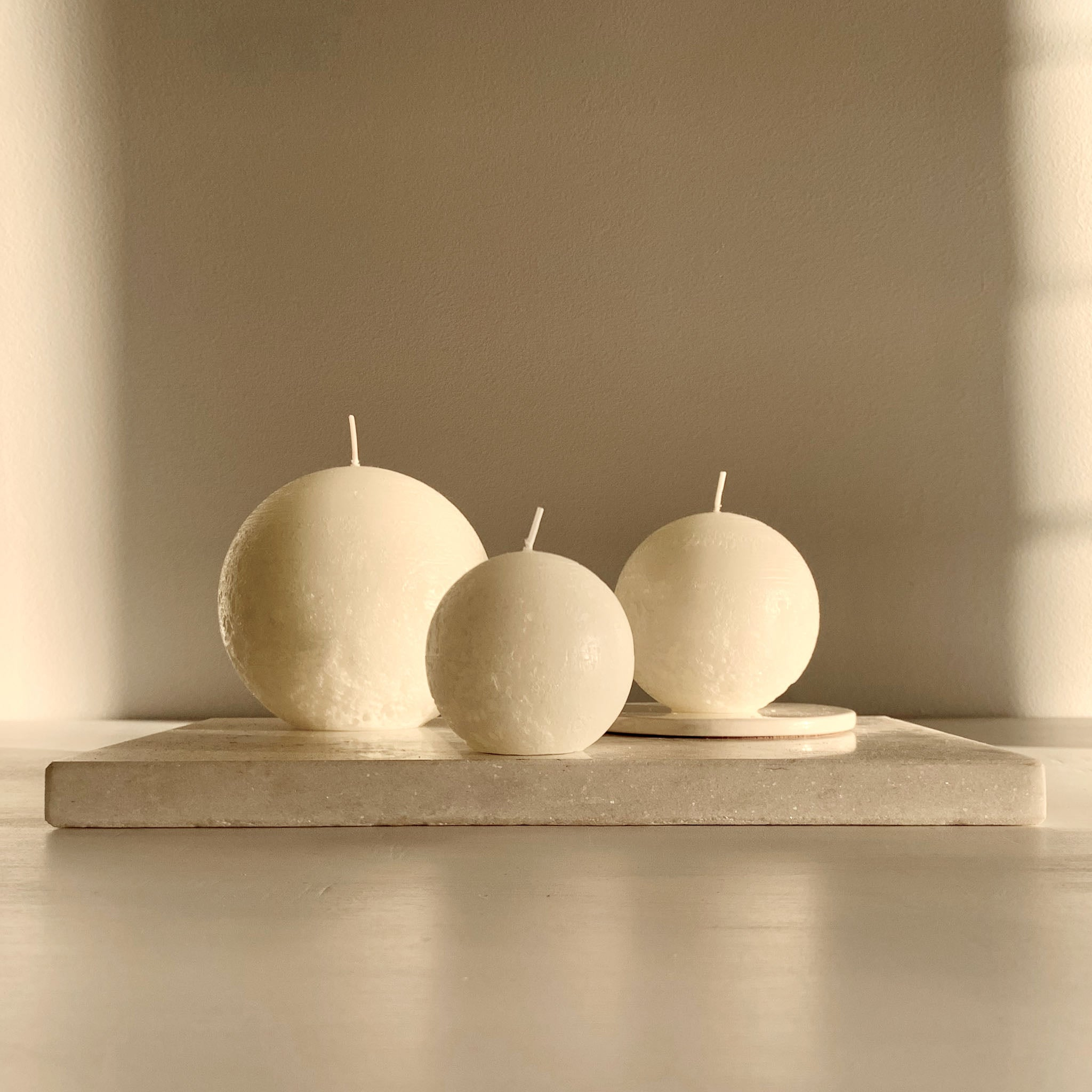 White rustic spherical candles