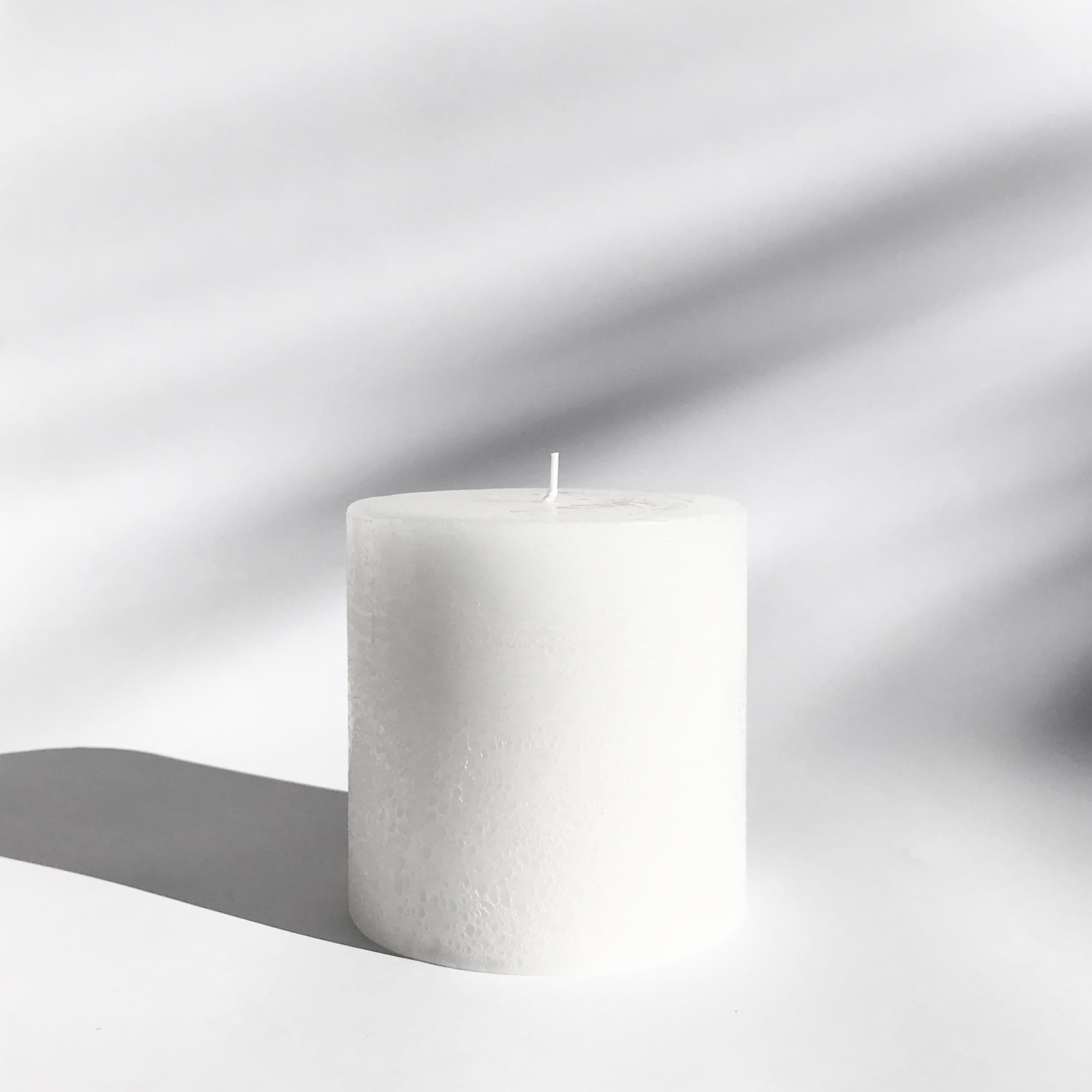 Textured pillar candle in white