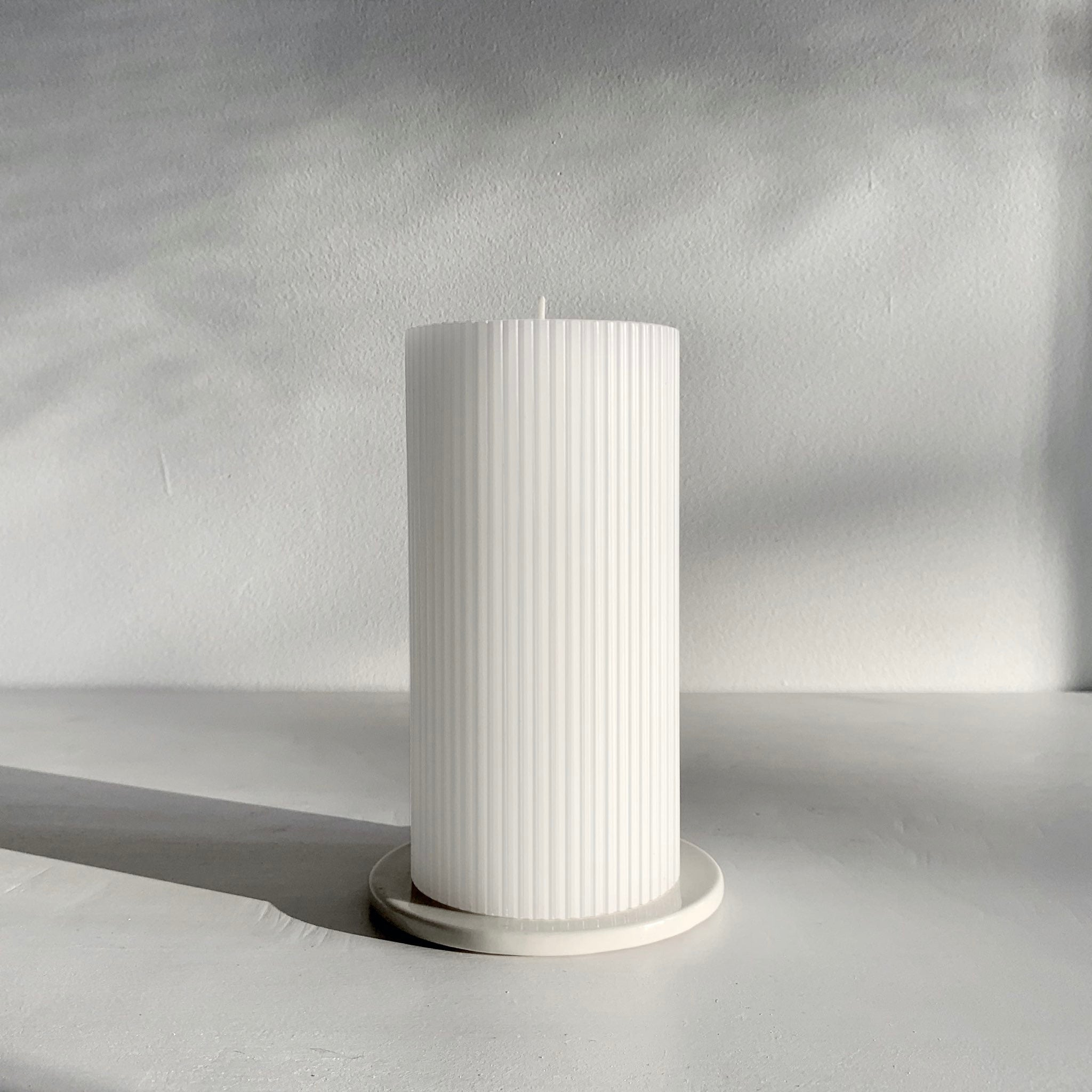 White grooved pillar candle