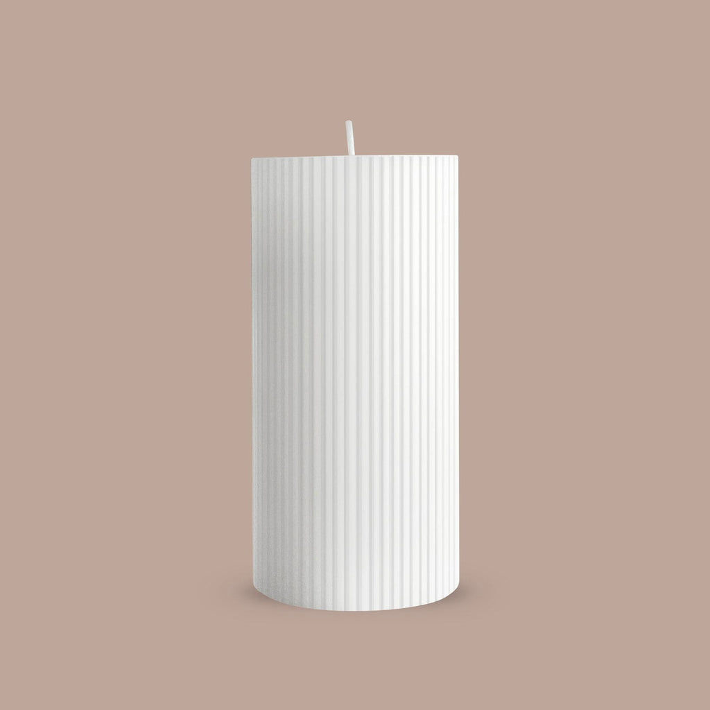 White ribbed column candle