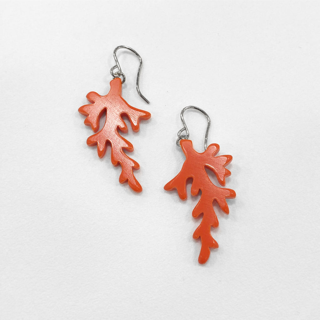 coral dangle earrings in red