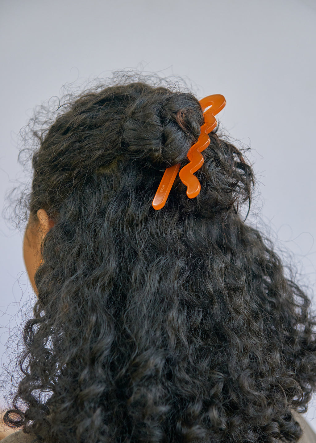 orange giant bobby pin hair stick bun