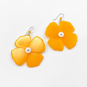 big orange flower earrings by woll