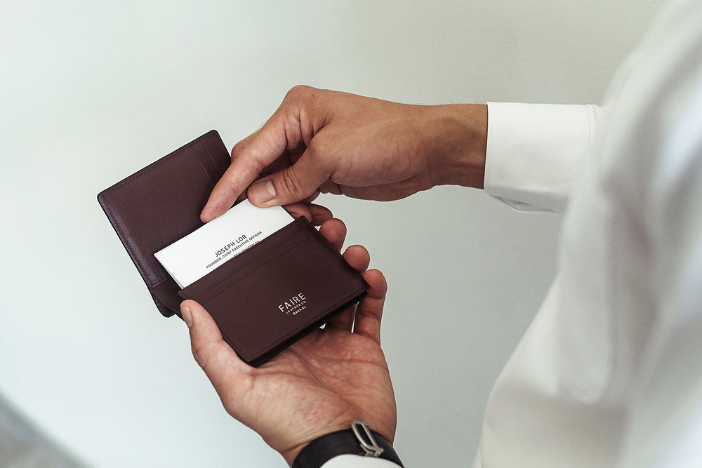 Combines a wallet with a business cardholder