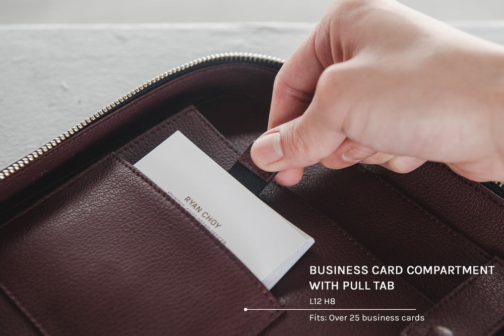 Business card compartment with pull tab