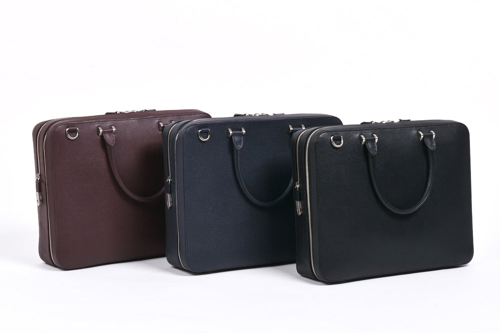 Bond Travel Briefcase in Textured Cross Grain Cowhide (L to R): Burgundy, Navy, Black