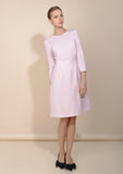 Looking fresh and feminine in this classy pink wool dress, made to wear just as you like it - main image.
