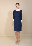 Classic style, blue work dress also available in black. Heaton check pattern dress - model view.