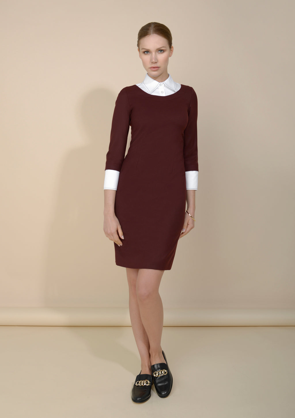 Deep Burgundy office dress with three-quarter length sleeves and just-above-the-knee length. Main photo.