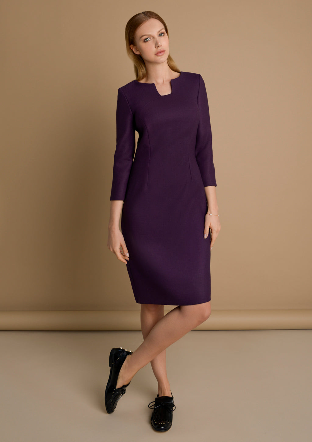 Classic wool dress for autumn by Kotys London. Full view picture.