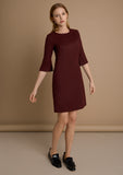Long sleeve work dress in burgundy. Roscoe by Kotys. Model view image.