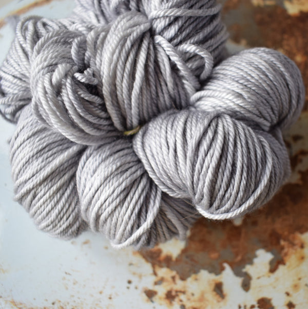 gingers hand dyed pep in your step worsted indie dyed superwash merino wool machine washable plump bouncy yarn indie dyed ginger twist studio dove light grey gray