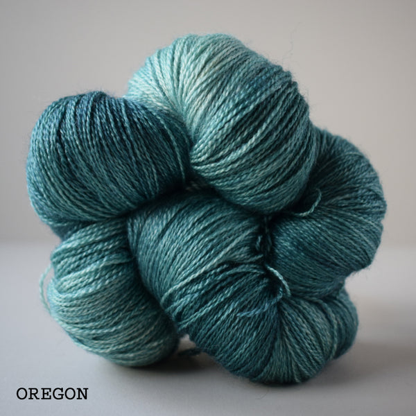 hand dyed green wool british bluefaced leicester bfl yarn and silk lace 2ply