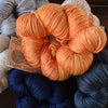 ginger's hand dyed splendor 4ply merino wool and silk soft smooth indie dyed yarn melon balls on fire orange