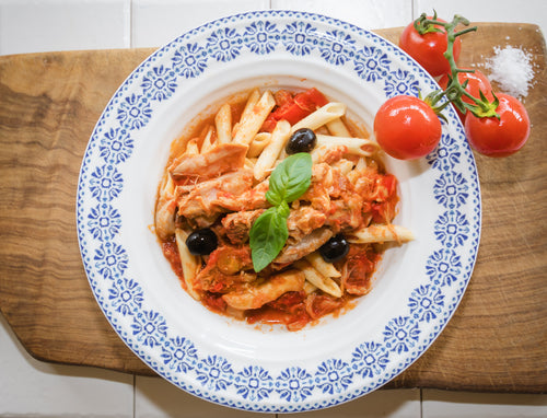 Chicken Cacciatore. Classic Italian dish, chicken braised in a tomato-based sauce with caramelised onion, smoky bacon, roasted red pepper, black olives and herbs