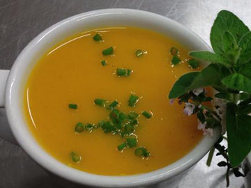 Deliciously smooth and coconutty roasted butternut squash soup with a hint of ginger.  Serves 1 All ingredients are prepared and cooked by hand. Ingredients: onion, butternut squash, carrot, ginger, garlic, celery,  chicken stock, parsley, sea salt & pepper. Allergens: celery. Reheating Instructions: This container cannot go into the oven.  DEFROST before reheating.  Loosen lid before reheating in microwave for 2 minutes or, even better, dispense into a saucepan and reheat, the old fashioned way!