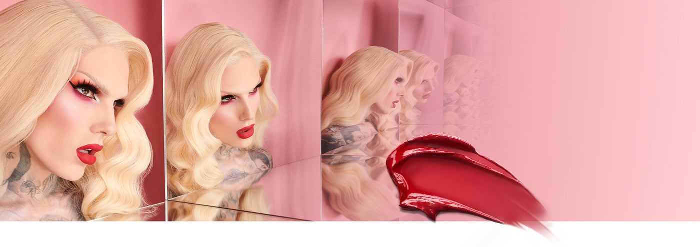 Jeffree Star and mirror reflections wearing red lipstick